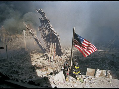 Three firefighters—George Johnson, Dan McWilliams and Bill Eisengrein—raising the American flag on September 11, 2001. This last of the series remains the most striking, yet least-known depiction of this scene.