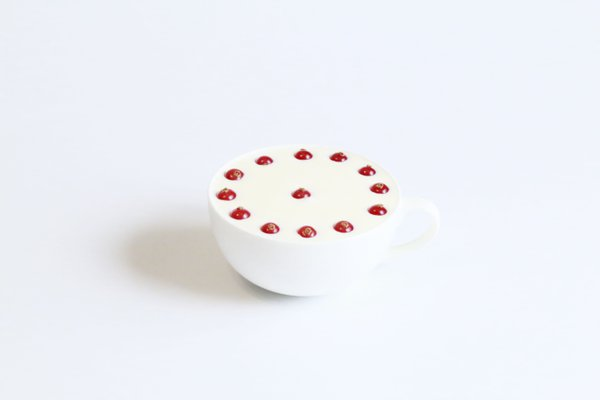 Red berries with white cup on a white thumbnail