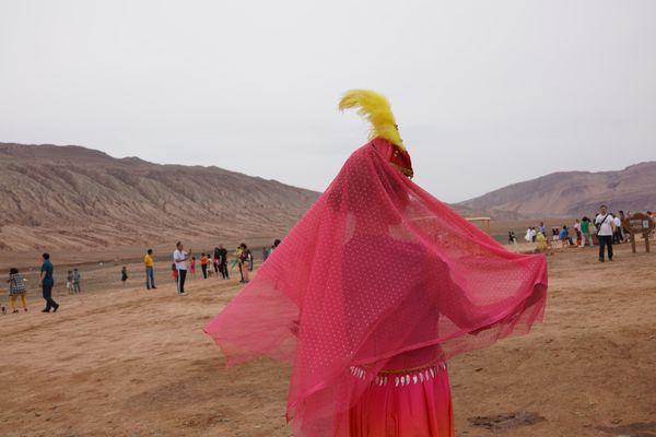 Performer poses for me at Flaming Mountains, Xinjiang thumbnail