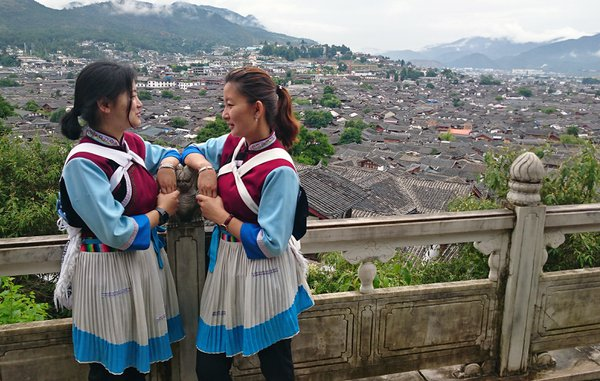 gossiping with traditional dresses thumbnail