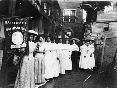 Nine African American women gather for the Banner State Woman's National Baptist Convention in 1915
