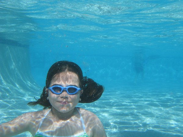 a girl smiles for the underwater camera thumbnail