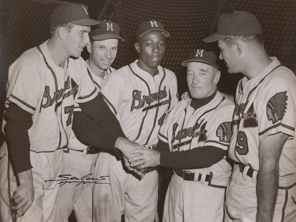 Hank Aaron (center) poses with his teammates in this 1956 photograph by Osvaldo Salas