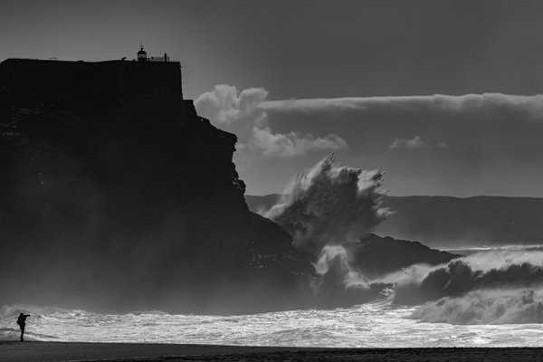Big waves breaking under the Nazare lighthouse thumbnail
