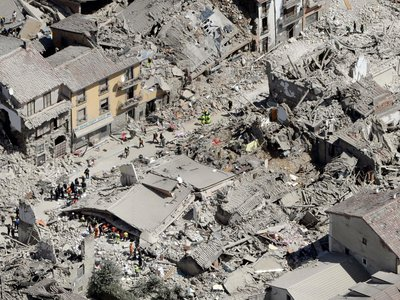 Rescuers search for survivors following the earthquake that struck central Italy early this morning.