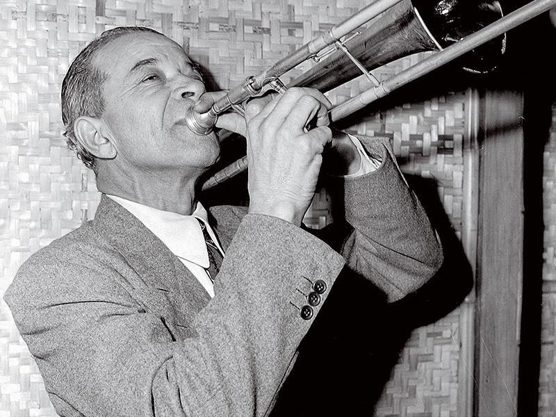 Kid Ory plays the trombone.