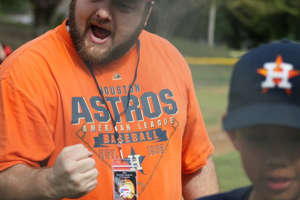 Little league Coach displays great emotion  for team work thumbnail