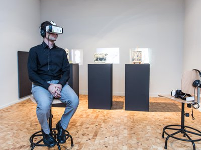 Virtual reality headsets at the 2015 International Documentary Film Festival Amsterdam allow visitors to view digital reconstructions of artifacts destroyed by ISIS.