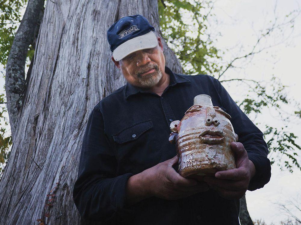 "Jim McDowell holds his jug, ""Emmett Till."" (Photo By Rimas Zailskas, courtesy of Asheville Made Magazine)"