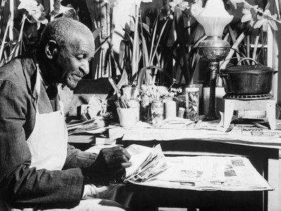 Botanist George Washington Carver, seen here in a 1940 photo, donated $33,000 in cash to the Tuskegee Institute to establish a fund to carry on the agricultural and chemical work he began.