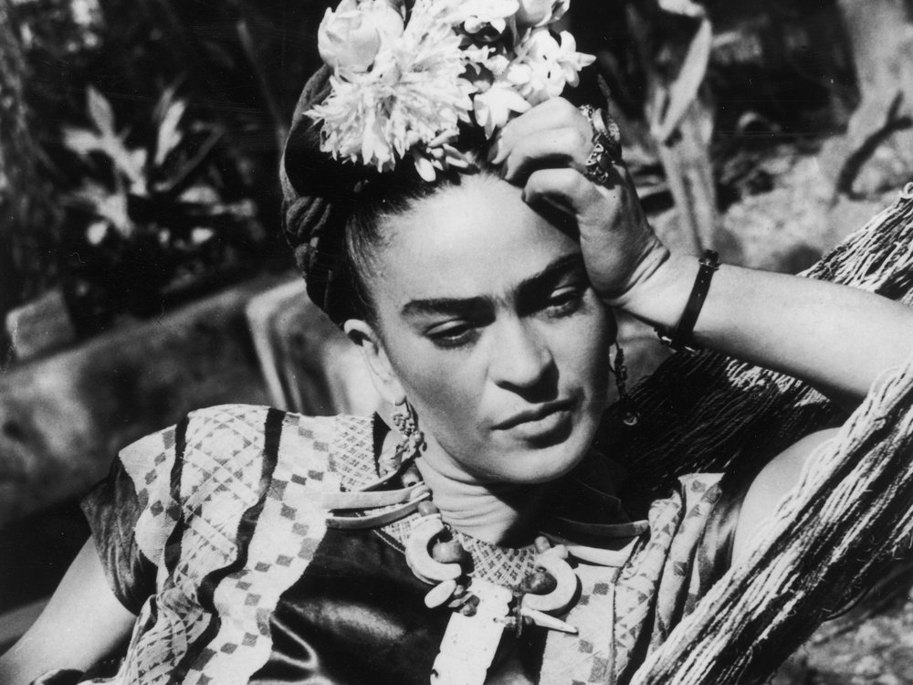 Frida Kahlo circa 1950 with flowers in her hair