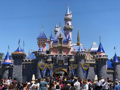 """Public health officials are transforming spacious, open-air venues like Disneyland into """"mega-site"""" vaccination centers."""