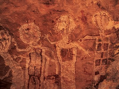 The Shamans' Gallery, a rock art panel that stretches across 60 feet of sandstone in a side canyon, displays an array of humanlike figures. One expert dates it to 1000 B.C. and believes it embodies the visions of unknown religious seers.