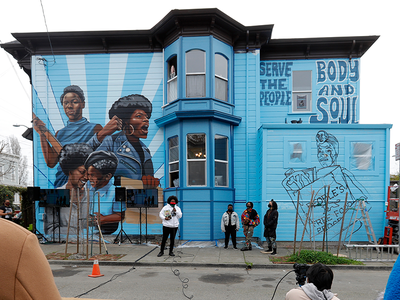 The mini museum is housed on the first floor of an Oakland, California, house whose exterior is decorated with a mural honoring the women of the Black Panther Party.