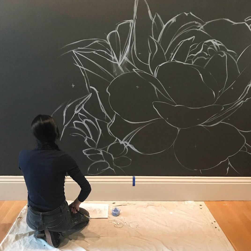 Ouizi at the early stages of the mural.