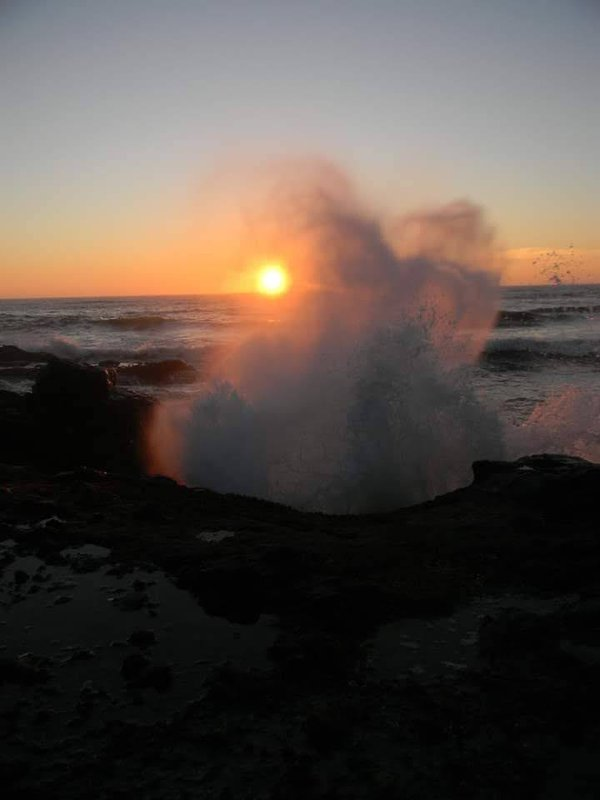 Sunset through a wave breaking thumbnail