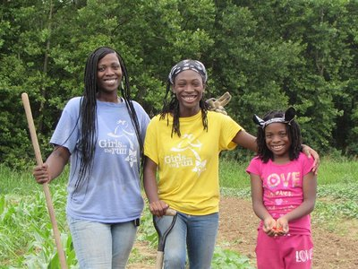 Xanthia DeBerry, with her daughters Angelica and Aniaya, is part of the seed saving project.