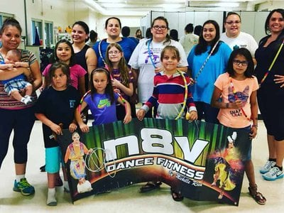 N8V Dance Fitness instructor Michelle Reed (far right) poses with participants of the Hannaville Indian Community of Michigan (Photo used with permission, courtesy of Michelle Reed)