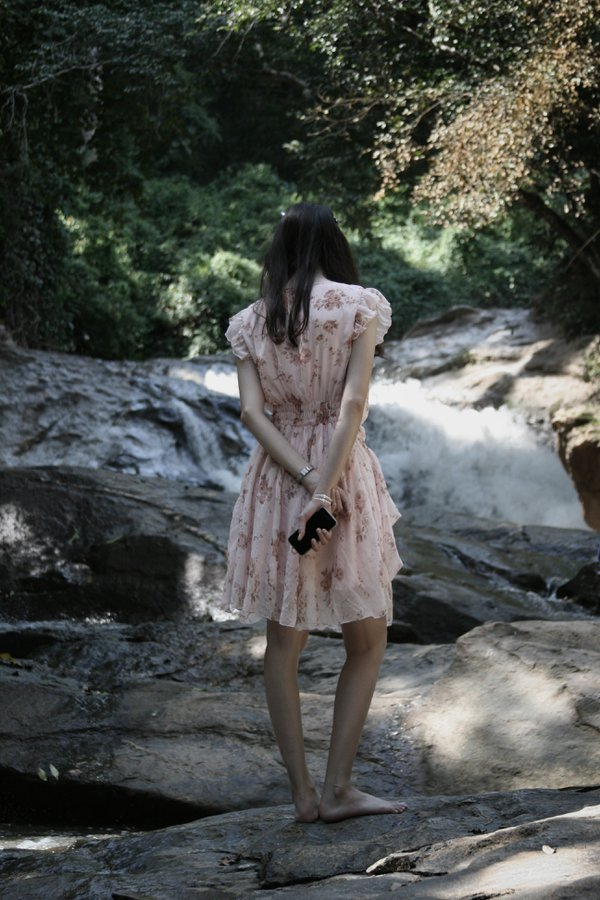 A lady at the waterfall thumbnail