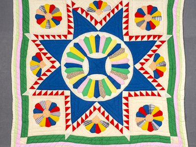 """Dresden Star Medallion Quilt"""" by Emma Russell. Object no. 2007.5001.0002 Anacostia Community Museum, Smithsonian Institution."""