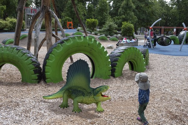 A boy meets a dinosaur in the playground. thumbnail