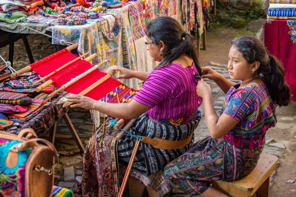 Daughter weaving mother's hair thumbnail