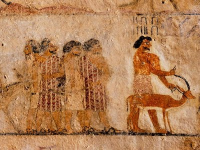 Wall art dated to around 1900 B.C. shows visitors to Egypt wearing colorful robes distinct from the white clothing worn by locals.