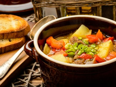 Goulash began as a humble soup-stew, cooked over an open fire by Hungarian herdsmen. The addition of refined varieties of paprika from ground red chilies made the dish an international staple.