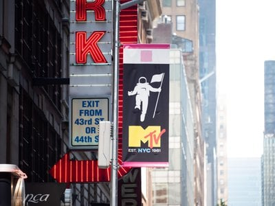 A flag in New York City's Times Square marks MTV's 40th birthday.