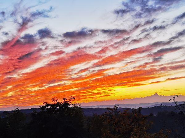 Sunset in San Martino Alfieri, Italia  viewing Italian Alps and Mont Viso thumbnail