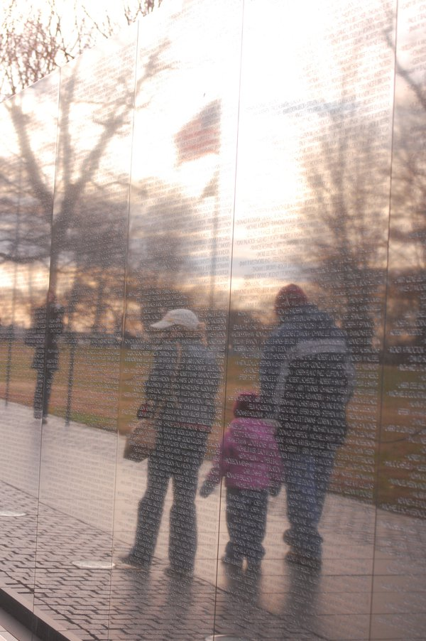 Teaching youth about our history. Three generations reflecting at the Wall. thumbnail
