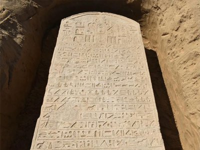 Archaeologists are working to decipher the slab's 15 lines of hieroglyphs.