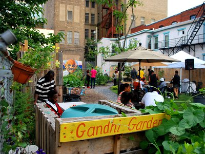 """Inspired by the quote """"you must be the change you wish to see in the world, the artists of the S.A.G.E. Coalition in Trenton, New Jersey transformed an abandoned lot into a vibrant community garden and gathering space."""