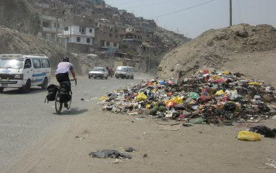 The miserable sprawl and slums of north Lima make a poor first impression for tourists fresh out of the airport. Here, the author's brother, Andrew, is shown 15 kilometers north of Lima, on the way to the mountain town of Canta.