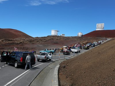 On October 7, 2014, protestors blocking the road, halted a groundbreaking ceremony for the Thirty Meter Telescope.