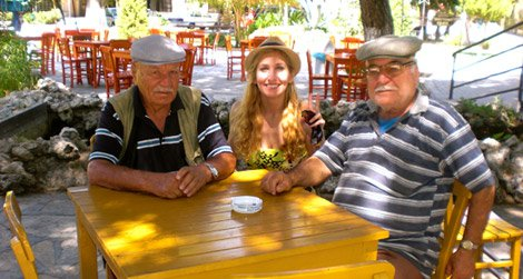 American backpacker Julia Pasternack shares a moment with two Turkish gentlemen.
