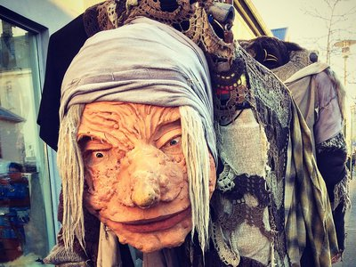 A townsperson walks around as Gryla, the Christmas Witch