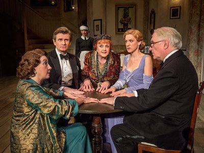 Angela Lansbury in her Tony Award-winning role as Madame Arcati, with Charles Edward as Charles Condomine, Simon Jones as Charles's friend Dr. Bradman, Melissa Woodridge as the ghost wife Elvira, Charlotte Perry as the second wife Ruth, Sandra Shipley as Mrs. Bradman, and Susan Louise O'Connor as the maid Edith.