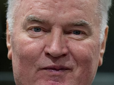 Bosnian Serb military chief Ratko Mladic enters the Yugoslav War Crimes Tribunal in The Hague, Netherlands, Wednesday, Nov. 22, 2017, to hear the verdict in his genocide trial.
