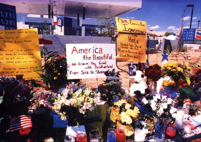 Bouquets in front of a gas station.