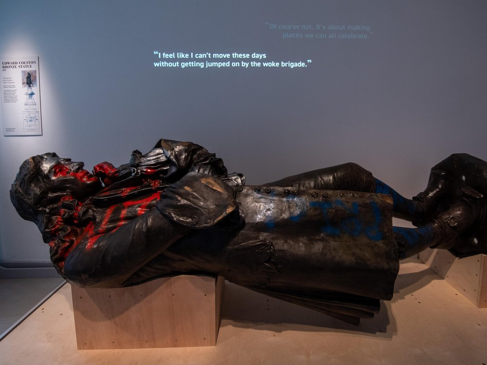 Defaced statue of Edward Colston lies supine in museum display