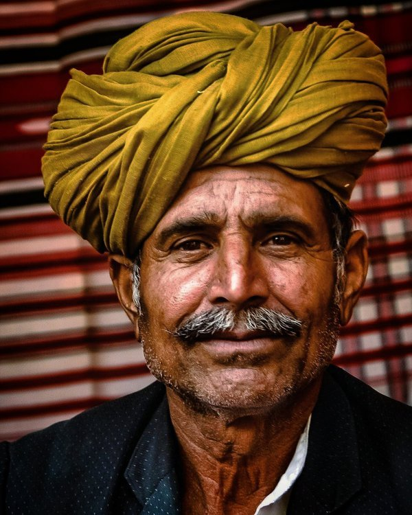 Man from rural areas selling traditional shawls thumbnail