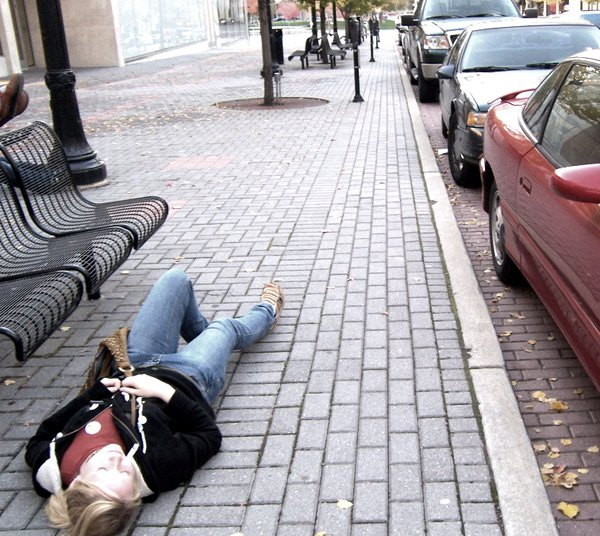 A young girl laying in the streets of Grand Rapids thumbnail