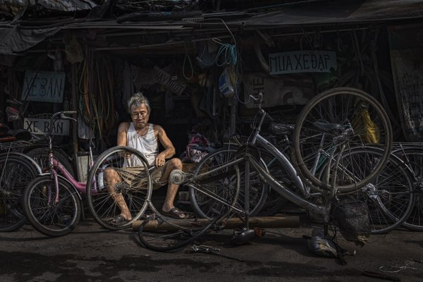 The old man with bicycle repair shop thumbnail