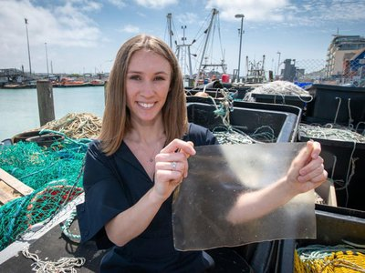 Lucy Hughes holds a piece of MarinaTex.