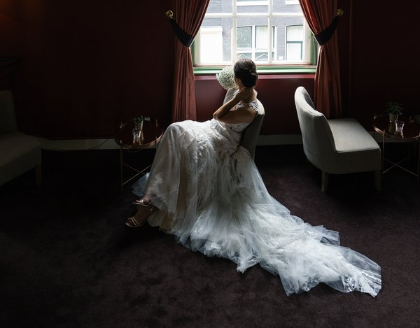 The bride at the window. Expectation. thumbnail
