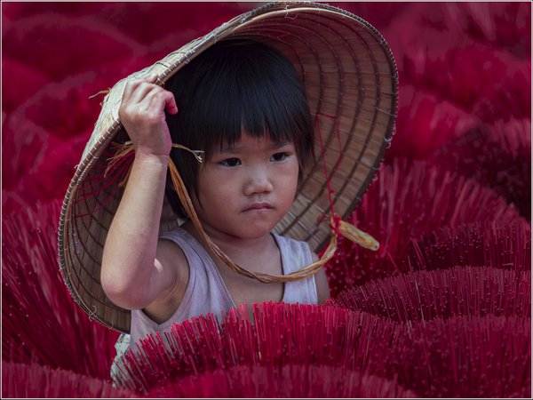 A little girl at incense village in Vietnam. thumbnail