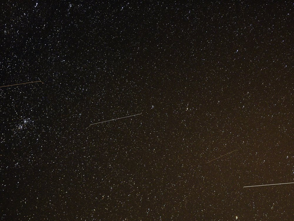 Meteors streak across the night sky during the Orionid meteor shower in Russia in 2016