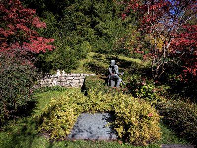 A sculpture depicting Irish author James Joyce is seen behind his grave in Fluntern cemetery in Zurich