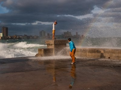 A wave splashes over the Malecón in Havana.